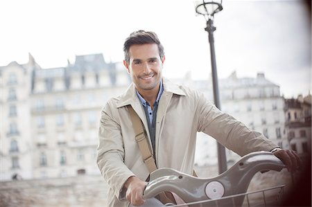 Businessman on bicycle, Paris, France Stock Photo - Premium Royalty-Free, Code: 6113-07543422