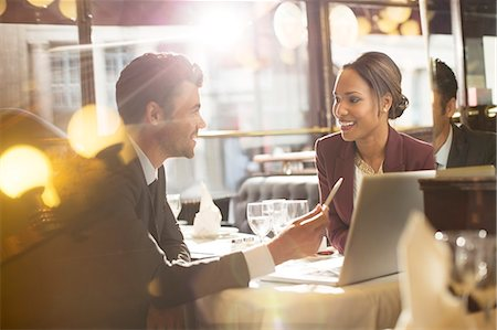 Business people talking in restaurant Stock Photo - Premium Royalty-Free, Code: 6113-07543434