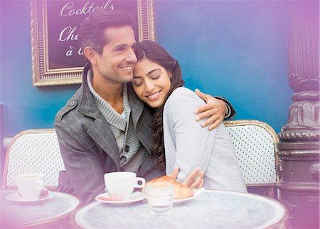 paris france cafe - Couple hugging at sidewalk cafe, Paris, France Stock Photo - Premium Royalty-Free, Code: 6113-07543549