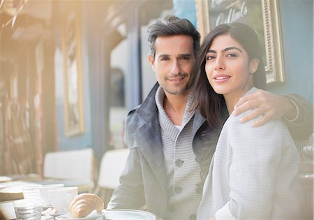 Couple sitting together at sidewalk cafe Stock Photo - Premium Royalty-Free, Code: 6113-07543563