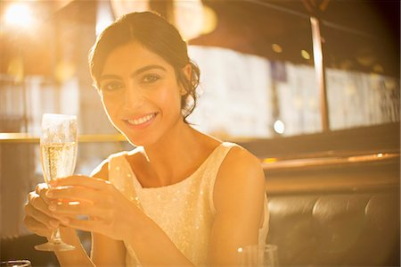rich lifestyle - Woman having champagne in restaurant Stock Photo - Premium Royalty-Free, Code: 6113-07543562