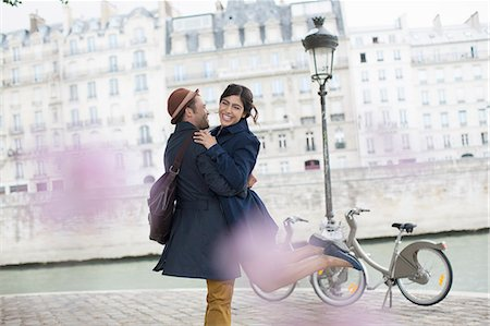 Couple hugging along Seine River, Paris, France Stock Photo - Premium Royalty-Free, Code: 6113-07543572