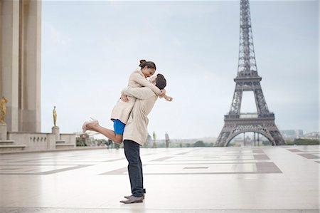 Couple hugging near Eiffel Tower, Paris, France Stock Photo - Premium Royalty-Free, Code: 6113-07543575