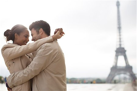 Couple hugging near Eiffel Tower, Paris, France Stock Photo - Premium Royalty-Free, Code: 6113-07543576