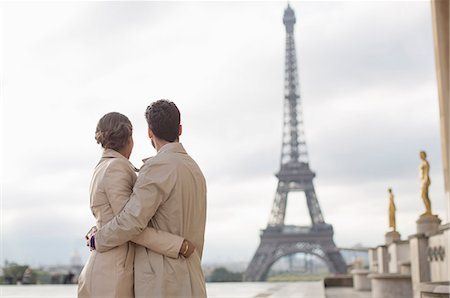 Couple admiring Eiffel Tower, Paris, France Stock Photo - Premium Royalty-Free, Code: 6113-07543581