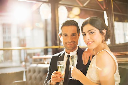 stock photograph - Couple drinking champagne in restaurant Stock Photo - Premium Royalty-Free, Code: 6113-07543585