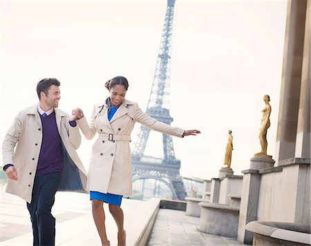 paris - Couple walking in front of Eiffel Tower, Paris, France Stock Photo - Premium Royalty-Free, Code: 6113-07543586