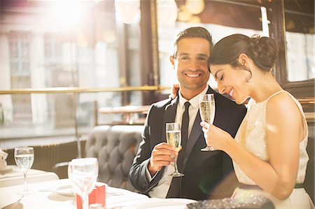 Well-dressed couple drinking champagne in restaurant Stock Photo - Premium Royalty-Free, Code: 6113-07543589