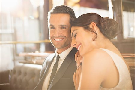 Well-dressed couple hugging in restaurant Stock Photo - Premium Royalty-Free, Code: 6113-07543591