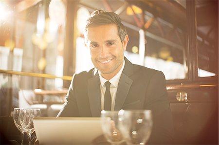 Man using digital tablet in restaurant Stock Photo - Premium Royalty-Free, Code: 6113-07543502