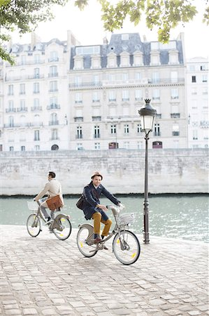 Men riding bicycles along Seine River, Paris, France Stock Photo - Premium Royalty-Free, Code: 6113-07543507