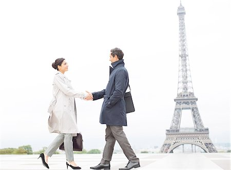 Business people shaking hands near Eiffel Tower, Paris, France Stock Photo - Premium Royalty-Free, Code: 6113-07543519