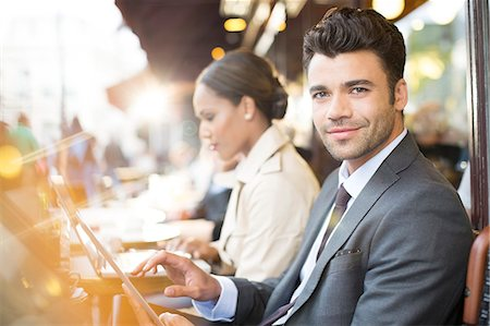 Business people working at sidewalk cafe Stock Photo - Premium Royalty-Free, Code: 6113-07543527