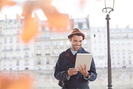 person - Businessmen using digital tablet along Seine River, Paris, France Stock Photo - Premium Royalty-Free, Code: 6113-07543525