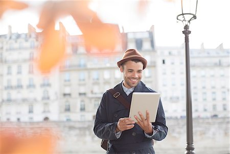 person - Businessmen using digital tablet along Seine River, Paris, France Stock Photo - Premium Royalty-Free, Code: 6113-07543525