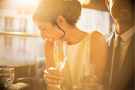 Couple having champagne together Stock Photo - Premium Royalty-Free, Code: 6113-07543536