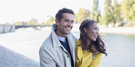 people and vacation - Couple walking along Seine River, Paris, France Stock Photo - Premium Royalty-Free, Code: 6113-07543652