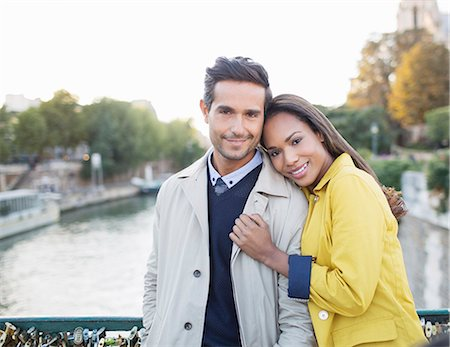 Couple hugging on Pont des Arts bridge over Seine River, Paris, France Stock Photo - Premium Royalty-Free, Code: 6113-07543675