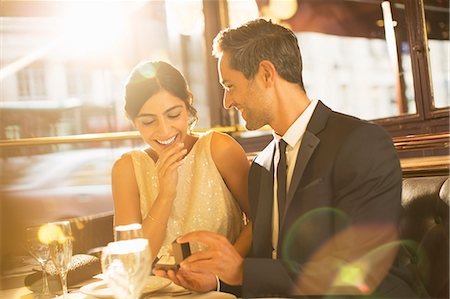 stock photograph - Man proposing to girlfriend in restaurant Stock Photo - Premium Royalty-Free, Code: 6113-07543606