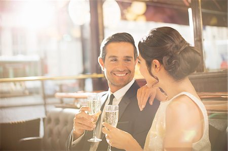 Couple drinking champagne in restaurant Stock Photo - Premium Royalty-Free, Code: 6113-07543617