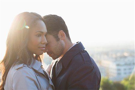 Couple hugging outdoors Stock Photo - Premium Royalty-Free, Code: 6113-07543622