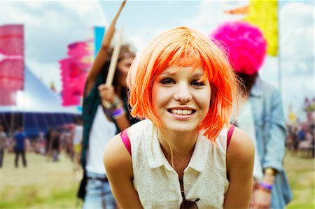 Portrait of woman in wig at music festival Stock Photo - Premium Royalty-Free, Code: 6113-07564754