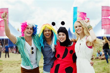 Portrait of friends in costumes at music festival Stock Photo - Premium Royalty-Free, Code: 6113-07564758