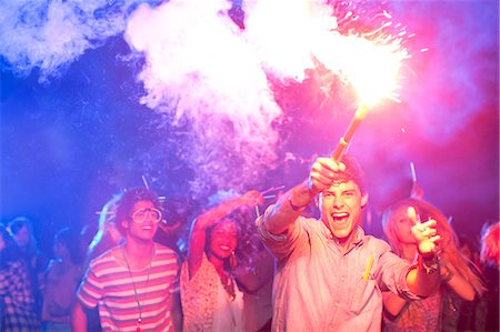 fireworks - Fans with fireworks at music festival Stock Photo - Premium Royalty-Free, Code: 6113-07564779