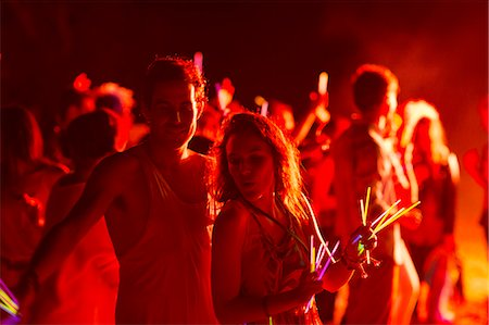 Couple dancing at music festival Stock Photo - Premium Royalty-Free, Code: 6113-07564783
