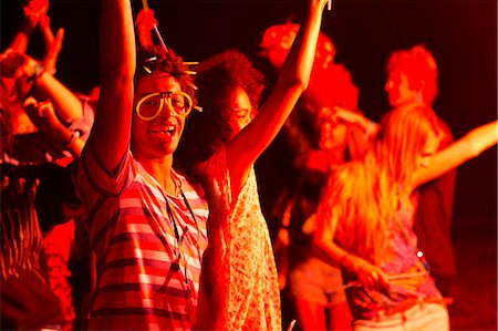 Friends dancing at music festival Stock Photo - Premium Royalty-Free, Code: 6113-07564782