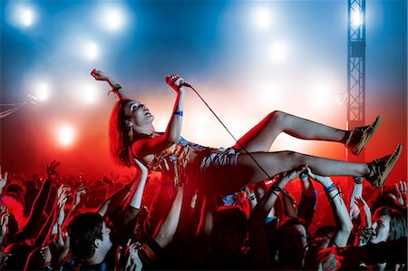 Performer crowd surfing at music festival Stock Photo - Premium Royalty-Free, Code: 6113-07564787