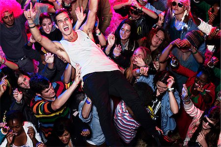 Man crowd surfing at music festival Stock Photo - Premium Royalty-Free, Code: 6113-07564799
