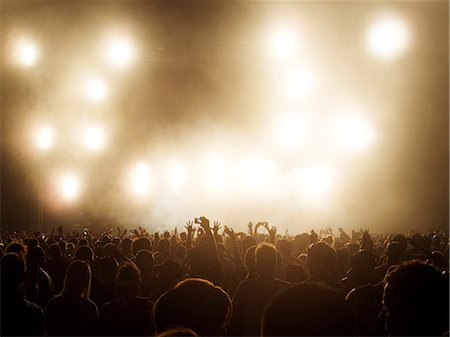 Silhouetted crowd watching illuminated stage at music festival Stock Photo - Premium Royalty-Free, Code: 6113-07564727