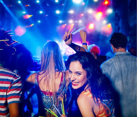 Woman with glow sticks at music festival Stock Photo - Premium Royalty-Free, Code: 6113-07564725