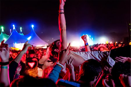 Man crowd surfing at music festival Stock Photo - Premium Royalty-Free, Code: 6113-07564733