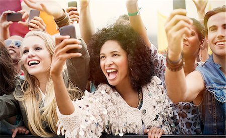 Fans with camera phones cheering at music festival Stock Photo - Premium Royalty-Free, Code: 6113-07564737