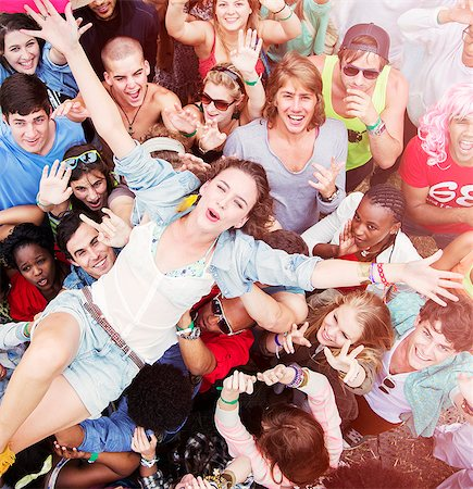 Enthusiastic woman crowd surfing at music festival Stock Photo - Premium Royalty-Free, Code: 6113-07564734