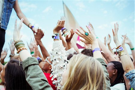 Fans reaching to shake hands with performer at music festival Stock Photo - Premium Royalty-Free, Code: 6113-07564847