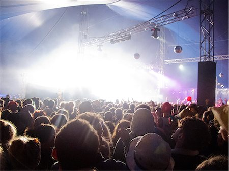 Fans facing illuminated stage at music festival Stock Photo - Premium Royalty-Free, Code: 6113-07564848