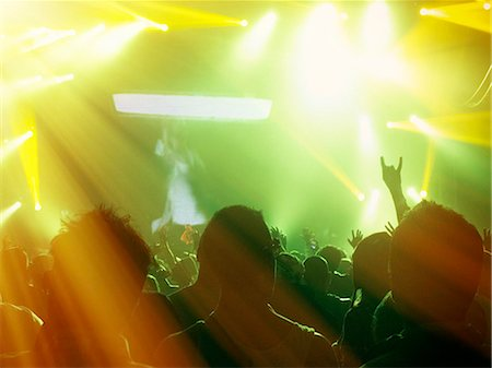 Silhouetted fans facing illuminated stage Stock Photo - Premium Royalty-Free, Code: 6113-07564862