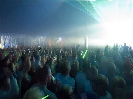 Crowd facing illuminated stage Stock Photo - Premium Royalty-Free, Code: 6113-07564871
