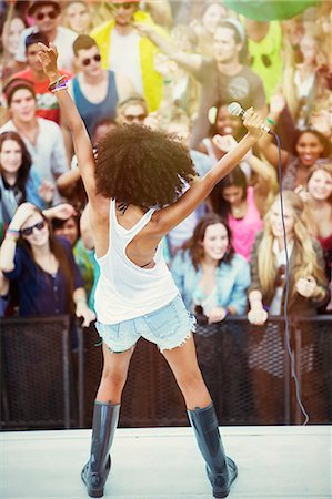 Fans cheering for woman performing on stage Stock Photo - Premium Royalty-Free, Code: 6113-07564884