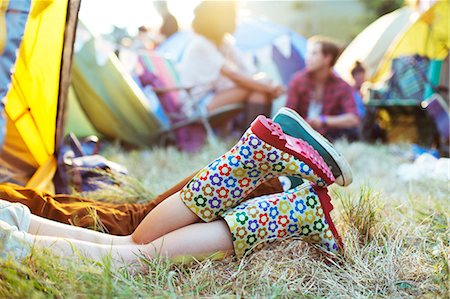 Couple's legs sticking out of tent at music festival Stock Photo - Premium Royalty-Free, Code: 6113-07564894