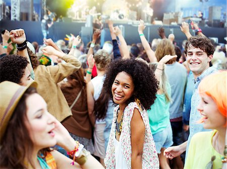 Fans dancing and cheering at music festival Stock Photo - Premium Royalty-Free, Code: 6113-07564801