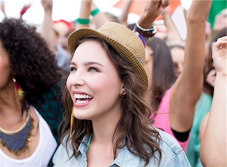 Happy woman at music festival Stock Photo - Premium Royalty-Free, Code: 6113-07564809