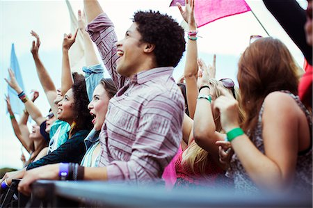 Fans cheering at music festival Stock Photo - Premium Royalty-Free, Code: 6113-07564813