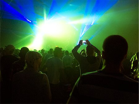 Silhouette of crowd facing illuminated stage at music festival Stock Photo - Premium Royalty-Free, Code: 6113-07564814
