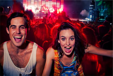 Enthusiastic couple cheering at music festival Stock Photo - Premium Royalty-Free, Code: 6113-07564816