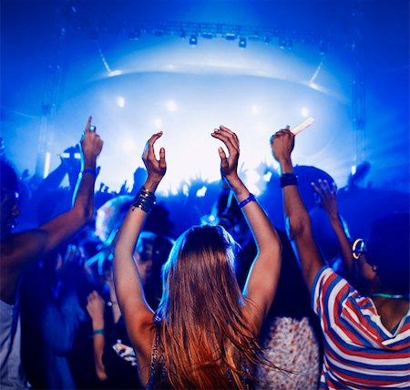 Fans dancing and cheering at music festival Stock Photo - Premium Royalty-Free, Code: 6113-07564818