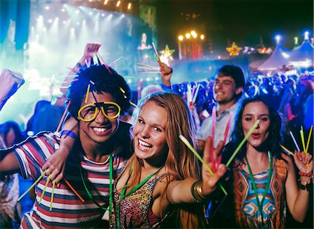 Portrait of friends with glow sticks at music festival Stock Photo - Premium Royalty-Free, Code: 6113-07564823
